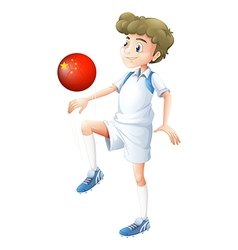 A boy using the soccer ball with the flag of China vector image