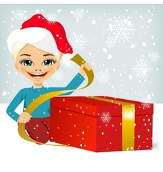 Cute little girl wrapping present vector