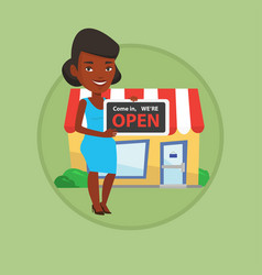 female shop owner holding open signboard vector image