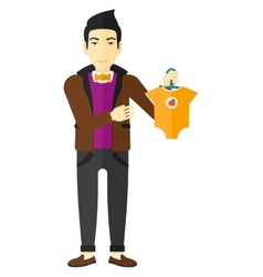 Man holding clothes for baby vector