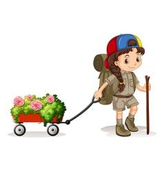 Little girl pulling wagon of flowers vector