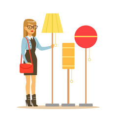 Woman choosing a living room lamp smiling shopper vector