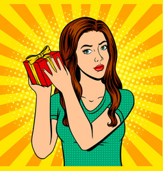 Girl with gift box pop art vector