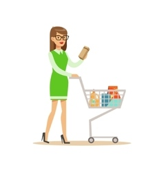 Woman in green dress with cart shopping in vector