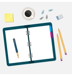office workspace with open book and objects vector image