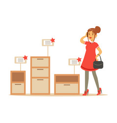 Woman choosing a night stand with drawer smiling vector