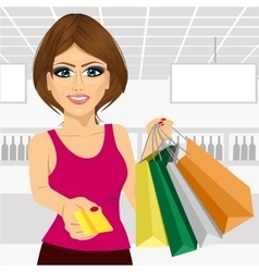 Young woman holding shopping bags vector