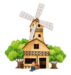 A big wooden house with a windmill vector image