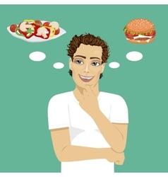 young man choosing between hamburger and salad vector image
