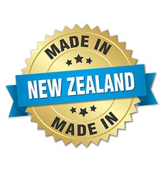 Made in new zealand gold badge with blue ribbon vector
