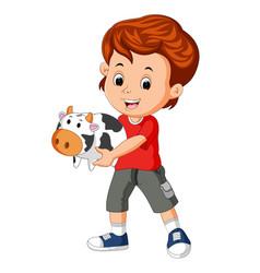 Little boy holding cow bank vector