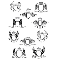 Heraldic winged shields with crowns and ribbon vector