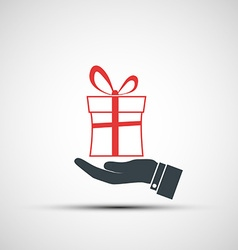 Hand holding a box with a gift vector