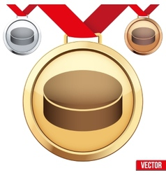Gold medal with the symbol of puck ice hockey vector