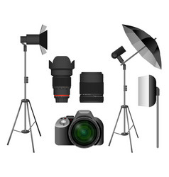 Modern camera with lenses and lighting equipment vector
