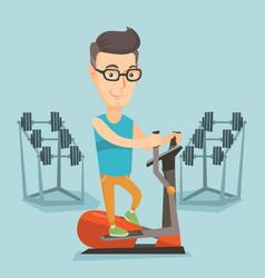 man exercising on elliptical trainer vector image