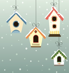 Abstract hanged bird house set in snowfall vector