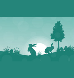 silhouette of easter bunny on green backgrounds vector image vector image