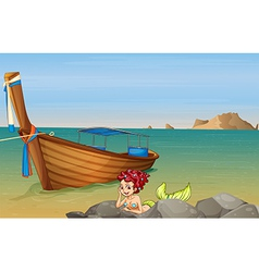 A mermaid at the sea near the wooden boat vector image