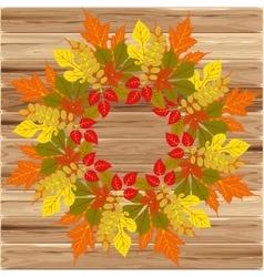 Autumn frame on wood background vector image