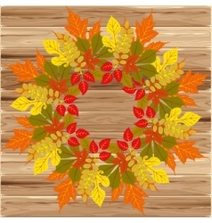 Autumn frame on wood background vector image
