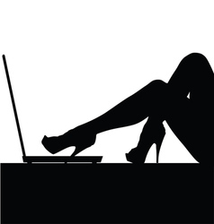 Woman legs on laptop silhouette vector