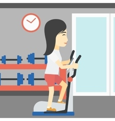 Woman exercising on elliptical trainer vector image vector image