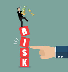 businessman standing on shaky risk blocks by hand vector image