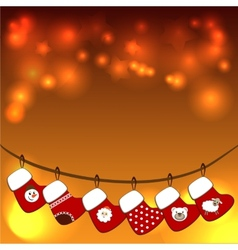 Christmas stockings on a rope vector