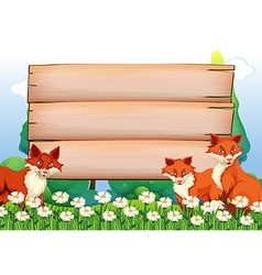 Wooden signs and foxes in garden vector