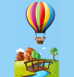 Kids riding balloon over the field vector