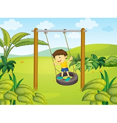 A little boy swinging vector
