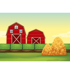 Farm scene with barns and haystacks vector