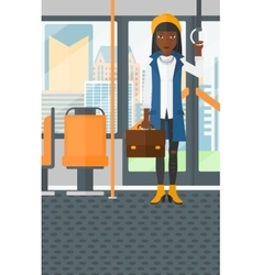 Woman standing inside public transport vector