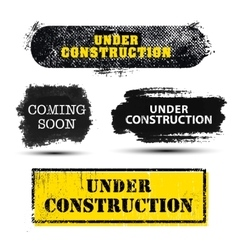 Set of grunge textured under construction vector