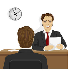 young man sitting at desk in front of future boss vector image vector image
