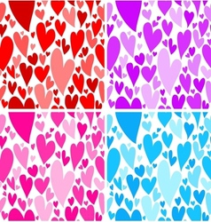 Set of four seamless patterns with doodled hearts vector