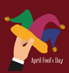 April fools day hand holding hat joker vector