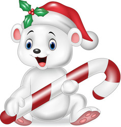 Cute baby polar bear holding christmas candy vector