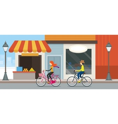 Couple riding bicycles in town vector