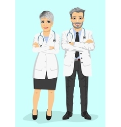 Mature doctors standing with arms folded vector
