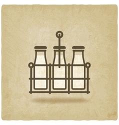 milk bottles in basket on old background vector image vector image