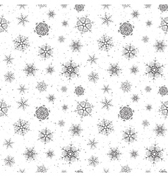 Seamless background of snowflakes vector