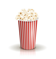 Full white-and-red striped bucket of popcorn vector