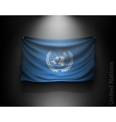 Waving flag united nations on a dark wall vector