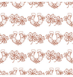 Seamless pattern with clover and horseshoe vector
