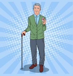 pop art senior man holding pills health care vector image vector image