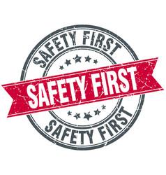 Safety first red round grunge vintage ribbon stamp vector
