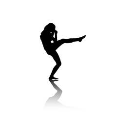Silhouette of woman kicking vector