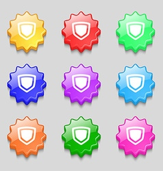 Shield icon sign symbol on nine wavy colourful vector